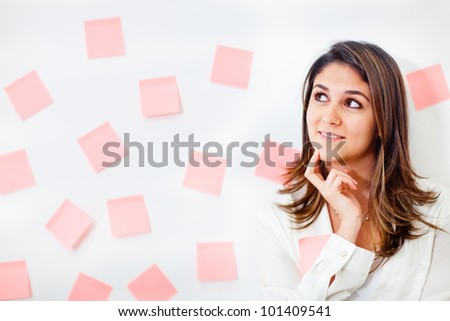 Pensive business woman thinking about her tasks - stock photo