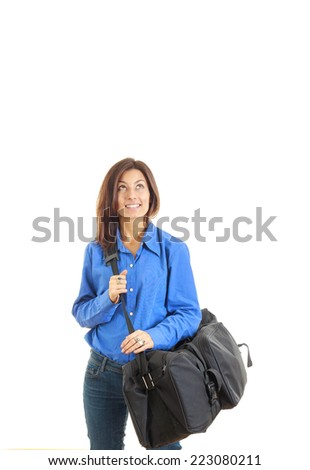 Pensive business woman with travel bag going on vacation daydreaming - stock photo