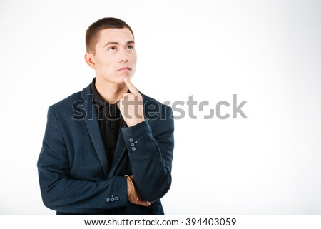 Pensive businessman looking up isolated on a white background - stock photo