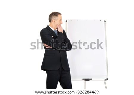 Pensive businessman thinking about presentation - stock photo