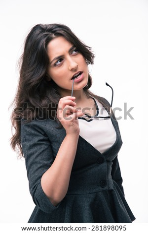 Pensive businesswoman looking up at copyspace isolated on a white background - stock photo