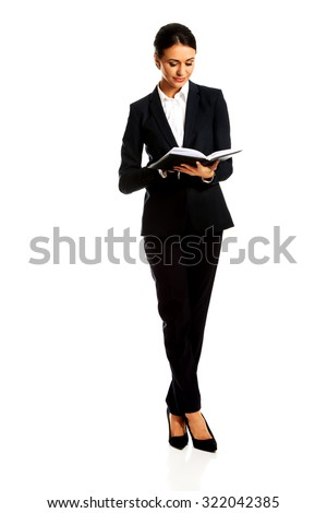 Pensive businesswoman reading her notes. - stock photo