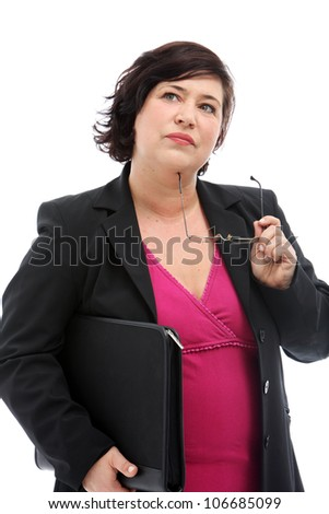 Pensive businesswoman standing looking up to the sky with her glasses against her chin making difficult business decisions - stock photo
