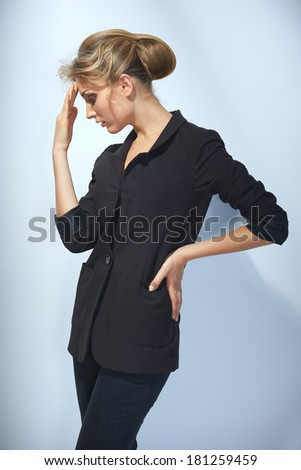 Pensive businesswoman with hand on forehead resolving a problem - stock photo
