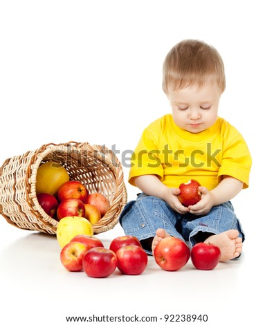 pensive child with healthy food red apples - stock photo