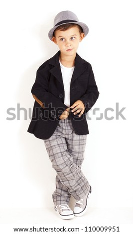 Pensive cool pretty stylish little boy - stock photo