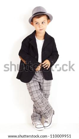 Pensive cool pretty stylish little boy - stock photo