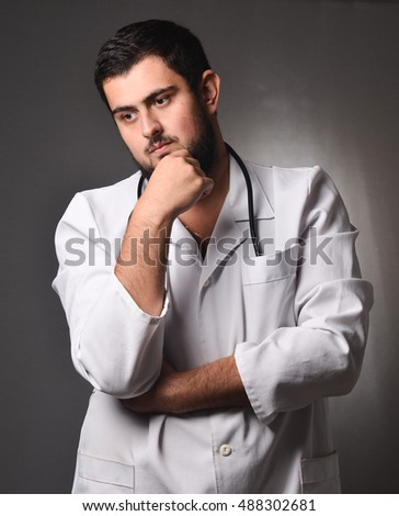 Pensive doctor in a white coat