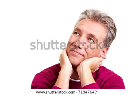 Pensive elderly man with grey hair looking thoughtfully up - stock photo