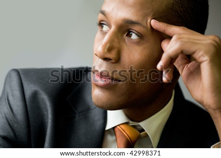 Pensive employee thinking of new ideas and looking aside - stock photo