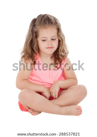 Pensive girl sitting on the floor isolated on a white background - stock photo