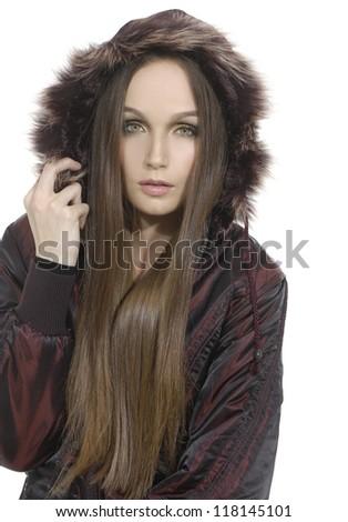 Pensive girl wearing a fur coat - stock photo