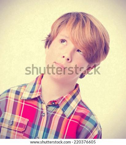 Pensive kid posing - stock photo