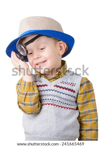Pensive little boy with glasses and hat on white background