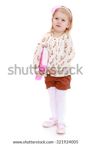 Pensive little girl in a white top and brown shorts holding under his arm a thick book-Isolated on white background - stock photo