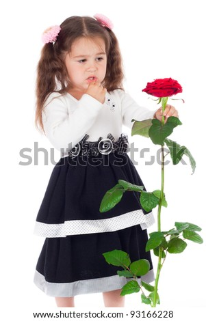 Pensive little girl with red rose, isolated on white - stock photo