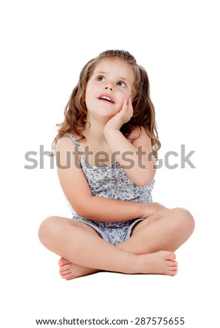 Pensive little girl with three year old sitting on the floor isolated on a white background - stock photo
