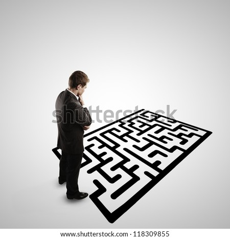 pensive man and  labyrinth on white background - stock photo