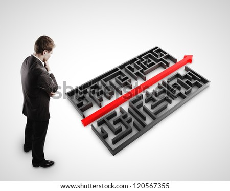 pensive man in front of maze on white background - stock photo