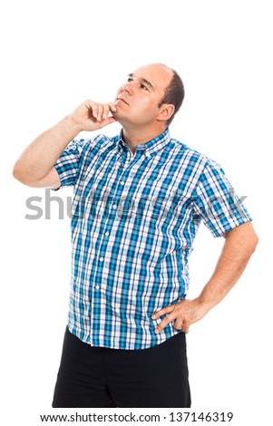 Pensive man looking up, isolated on white background - stock photo