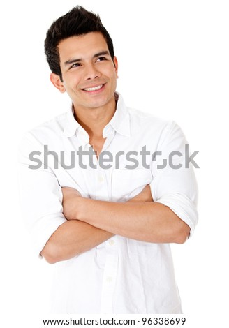 Pensive man looking up with arms crossed - isolated over white - stock photo