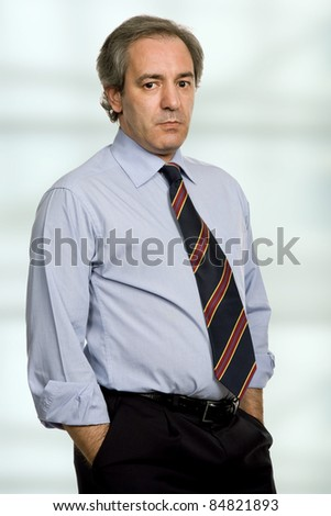 pensive mature business man at the office - stock photo