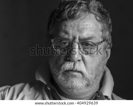 pensive mature man with glasses - stock photo