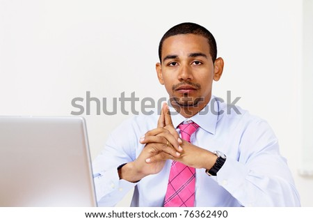 Pensive office manager - stock photo
