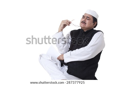 Pensive politician over white background - stock photo