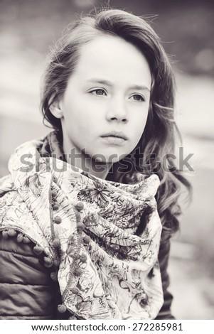 pensive portrait of girl in spring time - stock photo