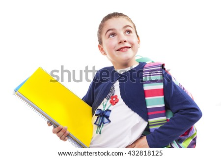 Pensive preschool student girl standing with notebooks and backpack on white background - stock photo