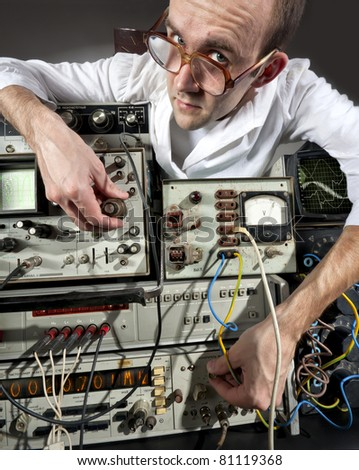 Pensive scientist working at vintage technological laboratory - stock photo