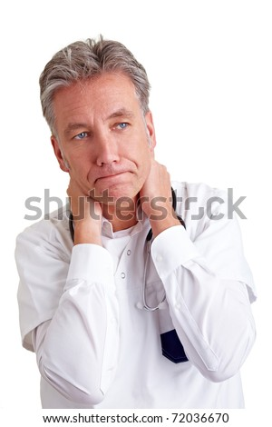 Pensive senior physician with grey hair looking worried - stock photo