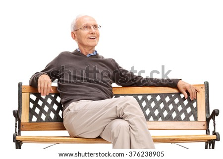 Pensive senior sitting on a wooden bench isolated on white background - stock photo