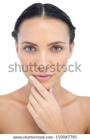 Pensive sensual model posing while touching her chin on white background - stock photo