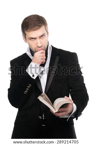 Pensive stylish man reading a book. Isolated over white background