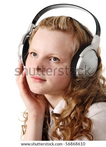 Pensive teenage girl with headphones - stock photo