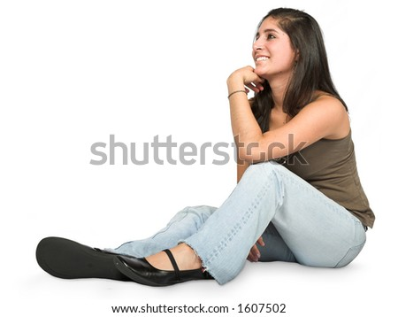 pensive teenager on the floor looking aside - over white background