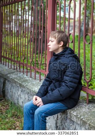 Pensive Teenager Portrait on the City Street - stock photo