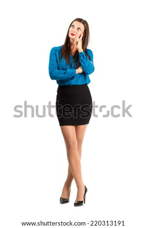 Pensive thinking business woman standing with crossed legs. Full body length isolated over white background. - stock photo