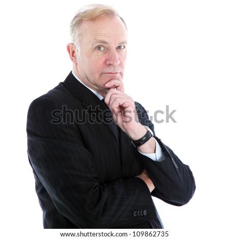 Pensive thoughtful businessman Pensive thoughtful middle-aged businessman with a serious expression standing looking at the camera with his chin resting on his hand