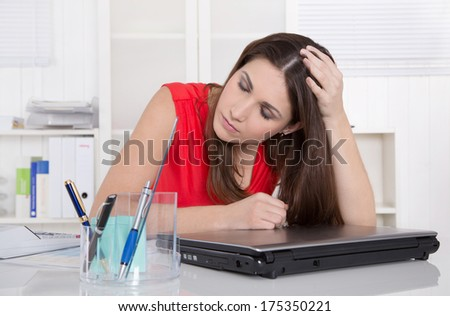Pensive trainee at desk at office.  - stock photo