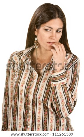 Pensive woman in long hair with fingers on lips - stock photo