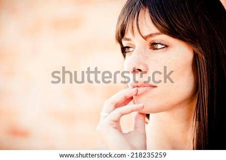 Pensive woman looking away - stock photo