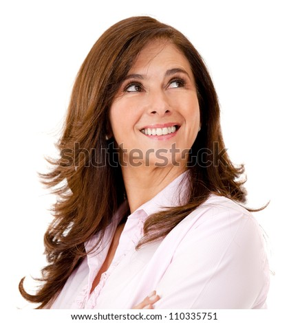 Pensive woman smiling and looking up - isolated over white - stock photo