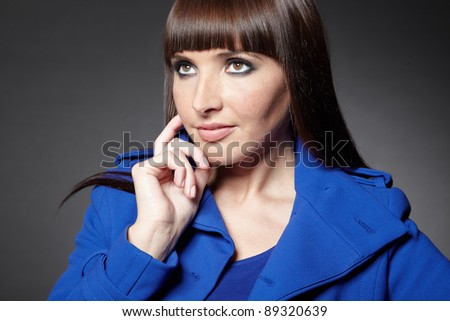 Pensive woman thinking with her hand on the chin
