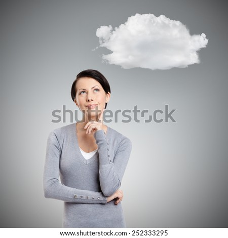 Pensive woman with cloud, isolated on grey
