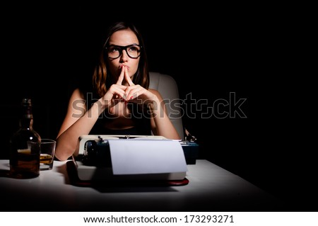 Pensive writer working on her book - stock photo