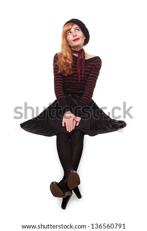 pensive young beautiful lady sitting on an edge of platform isolated on white background - stock photo