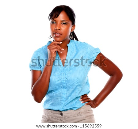 Pensive young black woman on blue shirt against white background - stock photo